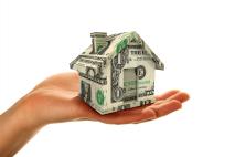 hand holding money house
